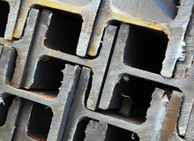 Interlocking steel beams. A closeup of interlocking or stacked steel I beams or girders used in building construction Royalty Free Stock Images