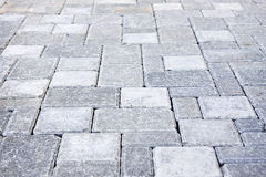 Interlocking stone driveway. Gray interlocking paving stone driveway from above Stock Images
