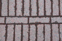 Interlocking stone driveway. Interlocking stones of a driveway. red interlocking paving stone driveway from above. angled block paving. Block paving layed at Stock Photo