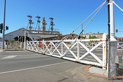 Interlocking swing gates in operation at a railway crossing Royalty Free Stock Photos