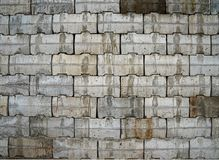 Interlocking wall with gray and brown concrete blocks. Concrete products Construction industry Stock Photos