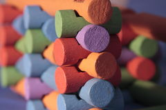 Interlocking wooden toy. Colorful interlocking wooden logs of building toy Stock Images