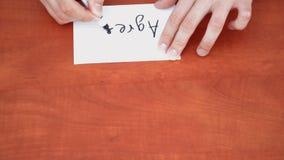 Interlocutor draws the word agree stock video footage