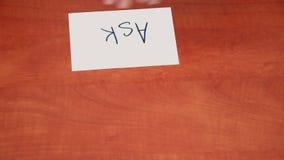 Interlocutor draws the word ask Stock Photo