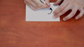 Interlocutor draws the word call Stock Photography