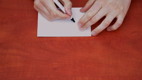 Interlocutor draws the word check Royalty Free Stock Photo