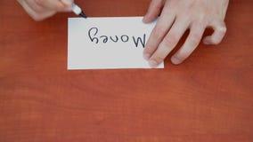 Interlocutor draws the word money Stock Photo