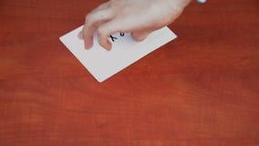 Interlocutor draws the word next stock video footage