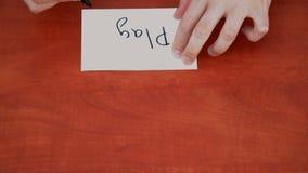 Interlocutor draws the word play Stock Images