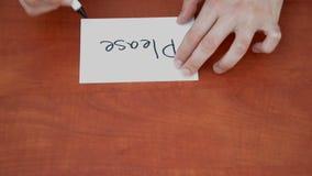Interlocutor draws the word please stock video