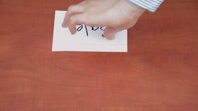 Interlocutor draws the word sale stock footage