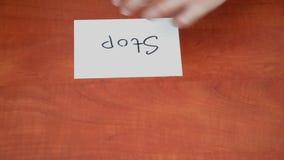 Interlocutor draws the word stop stock video footage