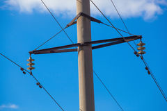 Intermediate, Transmission Line Costs Against The Sky Close-up Royalty Free Stock Photography