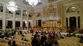 The intermission in a big beautiful hall of the Philharmonic of D. Shostakovich in Saint-Petersburg with visitors Stock Images