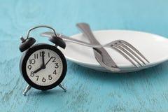 Intermittent fasta, bantar, begreppet för viktförlust royaltyfri foto