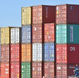 Intermodal containers stacked in freight yard stock photo