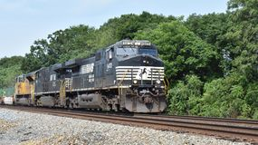 Intermodal freight train near Greenville SC. Norfolk Southern 9472 & 7630 and Union Pacific 8587 locomotives pull intermodal freight containers east on a two stock photos