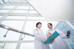 Intern and doctor Royalty Free Stock Image