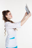 Intern girl looking at the x-ray picture Royalty Free Stock Photography