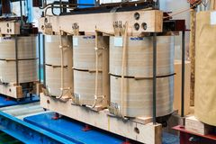 Internal active parts core and coils of transformer. Internal active parts core and coils of three phase distribution oil immersed transformer during in Stock Images