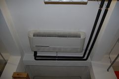 Internal airconditioning unit. And distribution pipes Stock Photos