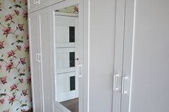 Internal details of the wardrobe. Large wardrobe. Details and close-up. royalty free stock images
