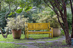 Internal garden with bench and flower vase Royalty Free Stock Photo