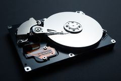 Internal hard disk drive isolated on a black background. Hacking of computer data royalty free stock images