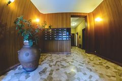 Internal interior of the entrance of a residential multi-storey building. In Italy stock images