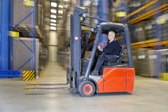 Internal logistics. Panned image Forklift driving through a warehouse. Concept for internal logistics, just in time delivery, next day delivery, service Royalty Free Stock Photography
