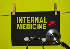 INTERNAL MEDICINE on top of yellow background royalty free stock images