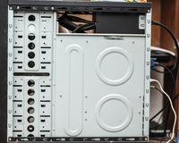 Internal part of the computer casing. Places for installation of hard drives and solid-state drives in the computer case stock images