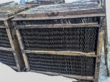 Internal parts of the end divider of the tube phases. Steel plates for better separation of water-oil emulsion. Stock Photography