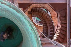 Internal structure of the bell tower with stairs and bell stock image