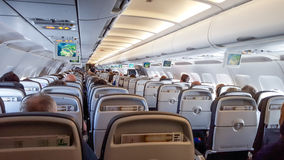 Internal view of an airplane in flight Stock Images