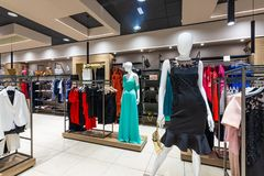 Internal view of a fashion store with generic jackets, mannequins, jeans and clothes. Internal view of a fashion store with generic jackets, mannequins, jeans stock image