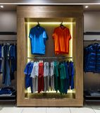 Internal view of a fashion store with generic jackets, mannequins, jeans and clothes. Internal view of a fashion store with generic jackets, mannequins, jeans stock photo