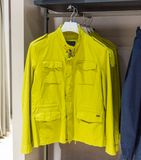 Internal view of a fashion store with generic jackets, mannequins, jeans and clothes. Internal view of a fashion store with generic jackets, mannequins, jeans royalty free stock images