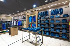 Internal view of a fashion store with generic jackets, mannequins, jeans and clothes. Internal view of a fashion store with generic jackets, mannequins, jeans stock images
