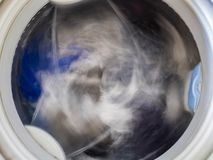 Internal view of a washing machine drum during wash. Top view. Stock Photography