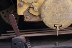 Internal workings of an antique clock movement Stock Images