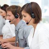 Internationaal commercieel team met hoofdtelefoon  Royalty-vrije Stock Foto's