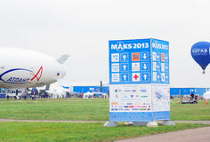 International Aerospace Salon MAKS-2013. Banner of International Aerospace Salon MAKS-2013, an aerostat and a balloon flying in the sky. Taken on August 30, 2013 Stock Image