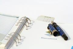 International Agenda. Agenda, planner and golden fountain pen Stock Image