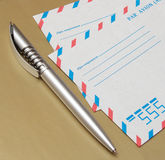 International air mail envelopes and a pen. Group of objects Stock Photography
