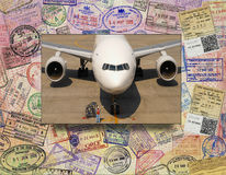 International Air Travel. Aviation and International Air Travel with background of passport visa stamps Stock Image