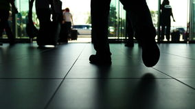 International airport business scene: people leaving and coming with luggage stock footage