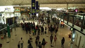 International Airport, People travelling with suitcase in arrived terminal stock footage