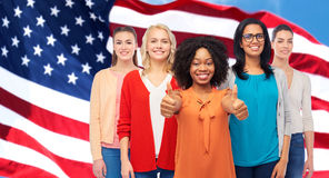 International american women showing thumbs up royalty free stock images