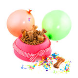 International animal day. Dog food for international animal day decorated with bow and balloons Stock Photo